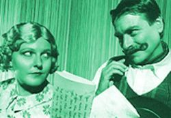 Deep-fried: Falstaff (Fritz Dickmann) and Meg Page (Kate Revnell-Smith) get dipped in Southern oil in the Houston Shakespeare Festival's production of The Merry Wives of Windsor.