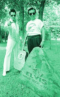 Asian Worldwide Elvis Fan Club President Henry Newinn and his son, Johnny Elvis, spend time every day at the Elvis stone in their backyard.