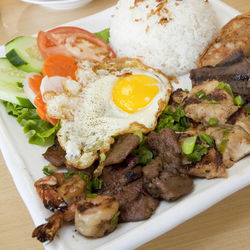 The mixed grill with sticky rice and a fried egg will blow you away.