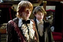 In the words of Ron Weasley (Rupert Grint, left, with  Daniel Radcliffe), the part with the dragon is bloody  brilliant.
