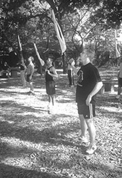 Bayousphere In formation: The Avante Color Guard practices for the Winter Guard International competition at Love Park in the Heights. The group of 16- to 21-year-olds hopes for a chance to compete at nationals in April 2002.