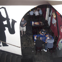 Sax Appeal: Mezzanine Lounge&#039;s two-tiered layout leads to interesting people-&amp;shy;watching at the laid-back sports bar/trivia lounge.