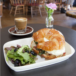 Relax with a breakfast croissant and a cortado.