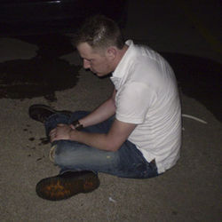 Chad Gibson, a 26-year-old computer technician, sits surrounded by vomit at the Rainbow Lounge the night Fort Worth police and TABC agents raided the gay bar. Gibson suffered head injuries at the hands of officers that left him hospitalized for a week.