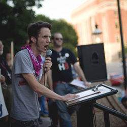 Queer LiberAction activist Blake Wilkinson speaks at the July 12 protest. Supporters from Dallas and other communities quickly rose in support of their Fort Worth neighbors, though not everyone in the city&#039;s gay community was exactly happy with the attacks on their city&#039;s reputation.