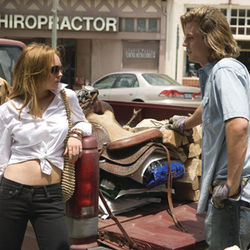 Lindsay Lohan (with Garrett Hedlund) can outgun almost any caricature.