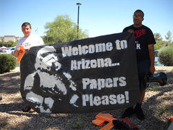 Anti&amp;#150;SB 1070 protesters sum up the situation in Arizona.