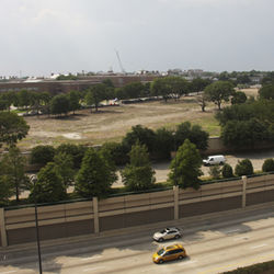 The empty site in front of the SMU campus is where the University Gardens condominiums sat for nearly 40 years until being demolished to make room for the 25-acre George W. Bush Presidential Center.