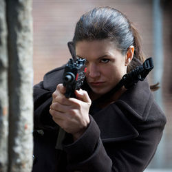 MMA fighter Gina Carano can play dom femme and express vulnerability.