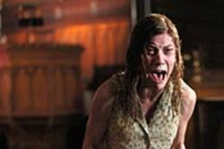 Jennifer Carpenter's role as Emily consists of lots of  demonic growling and spastic body movements.