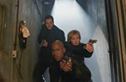 Johnny Lee Miller (left), Kathryn Morris and LL Cool J  shoot a slasher movie.