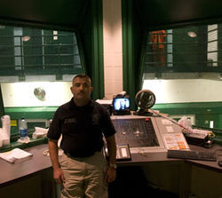Thomas Lopez-Ramirez oversees inmates in a mental health cell block at the Harris County Jail.