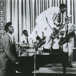 Grady Gaines's leap onto Little Richard's piano in the 1956 film Don't Knock the Rock was an iconic early rock and roll moment.