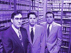 Mota (flanked by attorneys Ahmad, left, and Zavitsanos) won a $450,000 verdict.