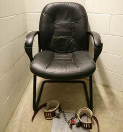 "Detainees are shackled to this chair in a ""habeas room"" in Camp 5 when their lawyers come to visit."