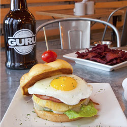 Guru Burgers gets creative with items like the pineapple-topped ukulele burger and beet chips.