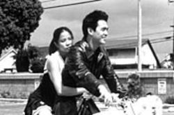 A bad boy's got to have a bike and a babe. Karin Anna Cheung and John Cho star in Better Luck Tomorrow.