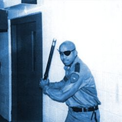 Hitter's stance: Williams posed for several menacing photos while he was a prison guard.