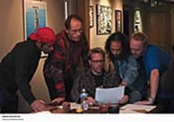 Metallica gets a shrink: Phil Towle (second from left)  looks at documents with the band.
