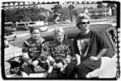 Mandy, Misty and Cindy Nixon take a break between practice races.