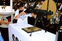 Nine-year-old Walter Burke scopes out a Socom II 