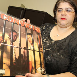 Julie Grob shows off one of the treasures from U of H's DJ Screw archive.