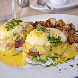 Get the crab cake Benedict with chipotle hollandaise.