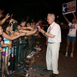 Peter Brown at the gay pride parade, with fans either reaching out Bobby Kennedy-style or trying to help him with whatever he&#039;s holding.