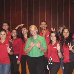 Candidate Annise Parker, either adamantly refusing to make the UH Cougar hand signal, or not knowing how to do so.