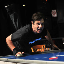 Phil Arnold is known around the United States Air Hockey Association (USAA) as a true finesse player. He uses everything he can — yelling, jumping up and down, and pretending to walk away from the table — to distract his opponents long enough to get an open shot at the goal.
