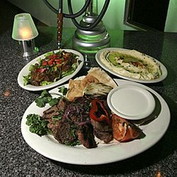 The beef kabob, with two sides, costs around ten dollars. Hookah extra.