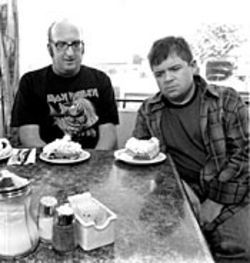 The pensive pie men: Brian Posehn (left) and Patton  Oswalt ponder a piece apiece.