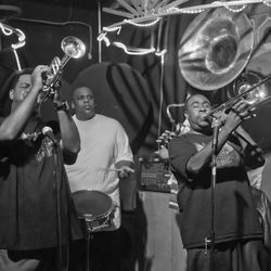 The New Orleans Hustlers Brass Band works that second-line groove.