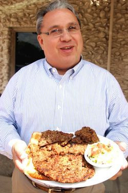 Fort Worth Star-Telegram CFS expert Bud Kennedy shows off his lunch at Mary's Café in Strawn.