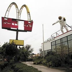 The astronaut survived; the Golden Arches didn't near NASA Road 1.