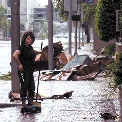GeSun Lee pauses while cleaning up the drive of the downtown Hyatt.