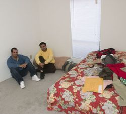 Rey Rodriguez (right) moved to Houston from the Texas border at the urging of his friend Silvino (left). The men live with another Cuban in a one-bedroom apartment in southwest Houston.
