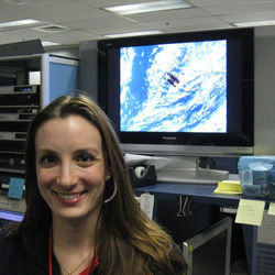 "As an aerospace engineer at NASA, Evans felt ""close"" to her projects. On the screen behind her, an unmanned vehicle makes its final approach to the International Space Station — a project she saw from ""cradle to grave."""