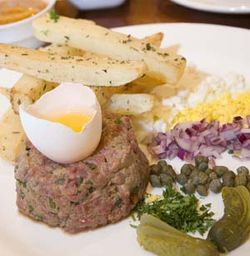 It takes some chutzpah to serve steak tartare these days.