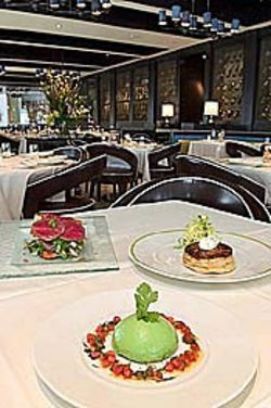 Chef Philippe Schmit's playful fare: Avocado-crab  bombe (front), Brie and duck Tatin and bison  napoleon.