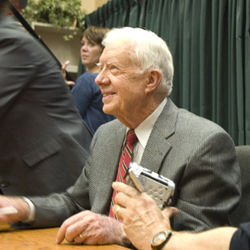 Jimmy Carter a benign presence.