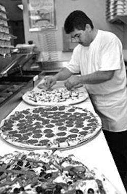 What Mario Flores doesn't do at Pizza Bella is as important as what he does.