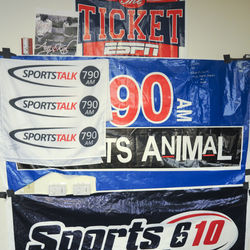 Stolen banners from rival sports radio stations marked with the names of the people who nabbed them and mock bumper stickers are part of 1560&#039;s encouraged anarchy.