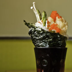 The WASP-y Kennedy Hand Roll showcases a large piece of tempura-battered lobster.