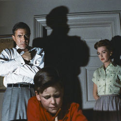 James Mason, Christopher Olsen and Barbara Rush in a scene from Bigger Than Life.