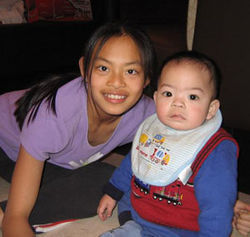 Raymond was constantly surrounded by family. Here with his cousin, Diana Diep.