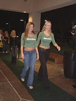 Heineken girls walk the green carpet.