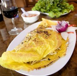 The banh xeo crepe skin isn't a wrapper — it's a stuffing.