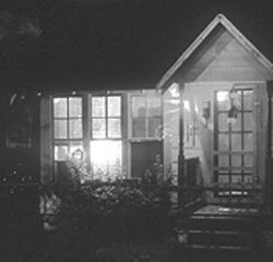 A quiet Halloween: A simple jack-o'-lantern is bathed in light in this house on Laird Street in the Heights.