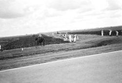 Bayousphere Nothing changes: A prison guard on horseback watches over inmates in the fields along FM 655 on the way to the Ramsey Unit.